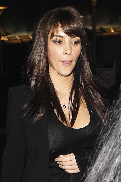 Kim Kardashian arrives at LAX airport with a new haircut featuring bangs