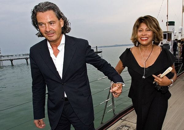 """Singer Tina Turner and her long-term German partner Erwin Bach arrive for the premiere of Giacomo Puccini's """"Tosca"""" in Bregenz"""