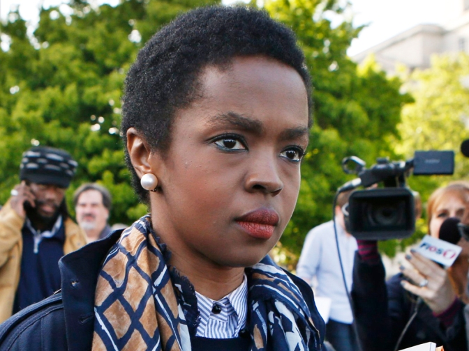 Image: Hip hop artist Lauryn Hill leaves United States Court after a sentencing on federal tax evasion charges in Newark